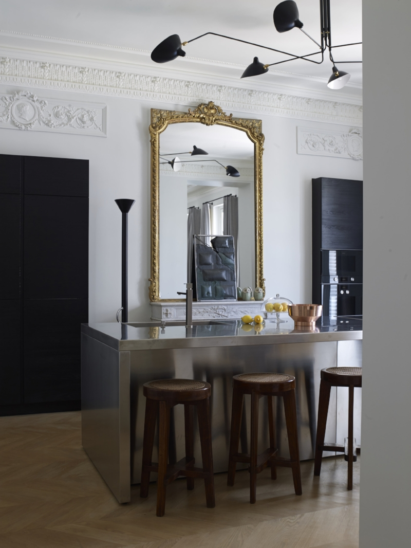 A contemporary kitchen insertion into an historic apartment. This is how its done folks. Photographer Gaelle le Boulicaut. Private residence in Paris