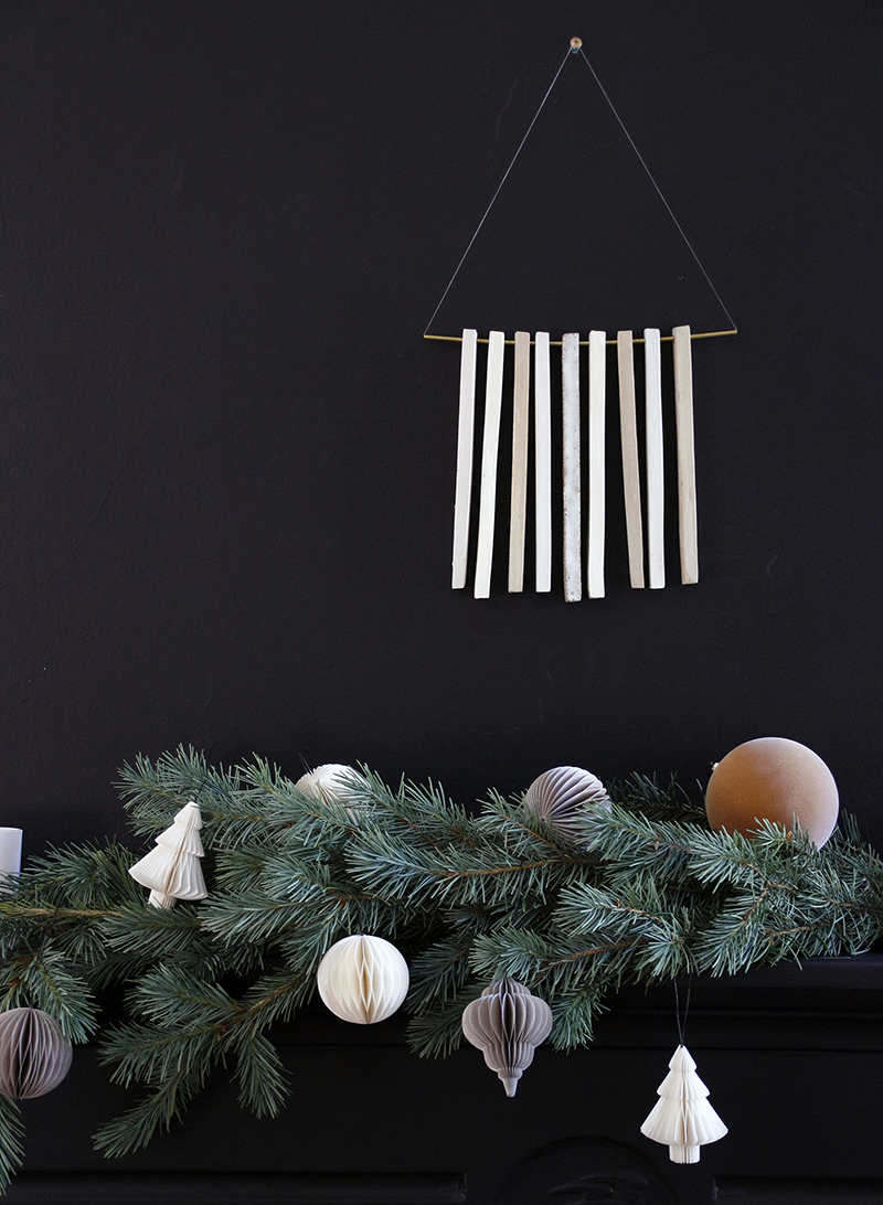 A fresh bunch of pine adds an instant Christmas vibe. Dot with Danish decorations available at  The Apartment.