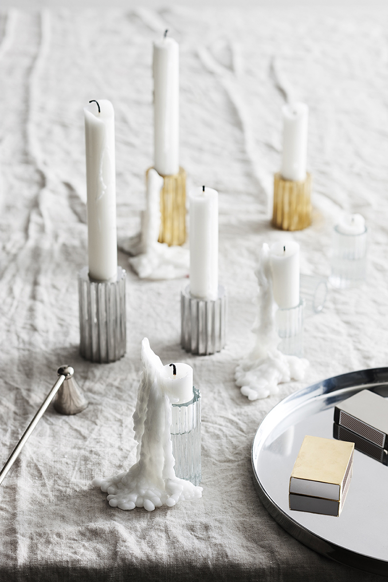 Dot sweet candles along a gorgeously crumpled linen table cloth and let the wax create