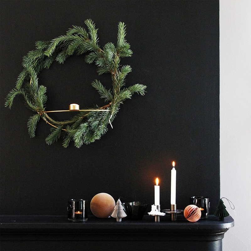 I wrapped a fresh bunch of pine around the  POV  for the easiest wreath ever. Scatter a few  Danish decorations  on the mantle, Light up those candles and be merry.