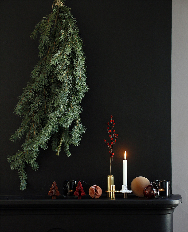 A simple pine branch is a contemporary way to bring some Christmas cheer into the home. Dot with delightful  Danish  decorations.