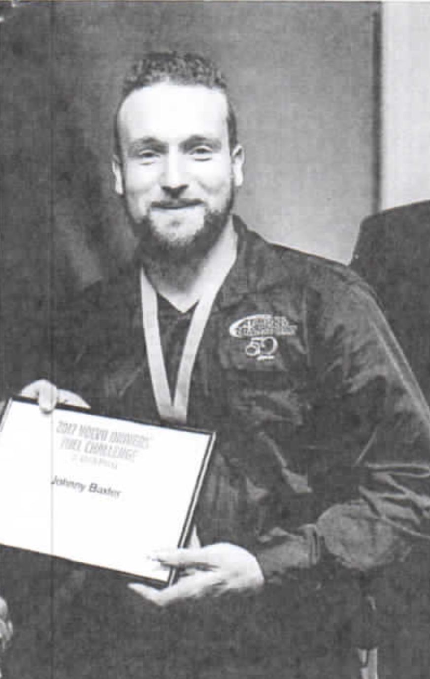 Baxter on receipt of his NZ award.  Source: NZ Trucking Magazine