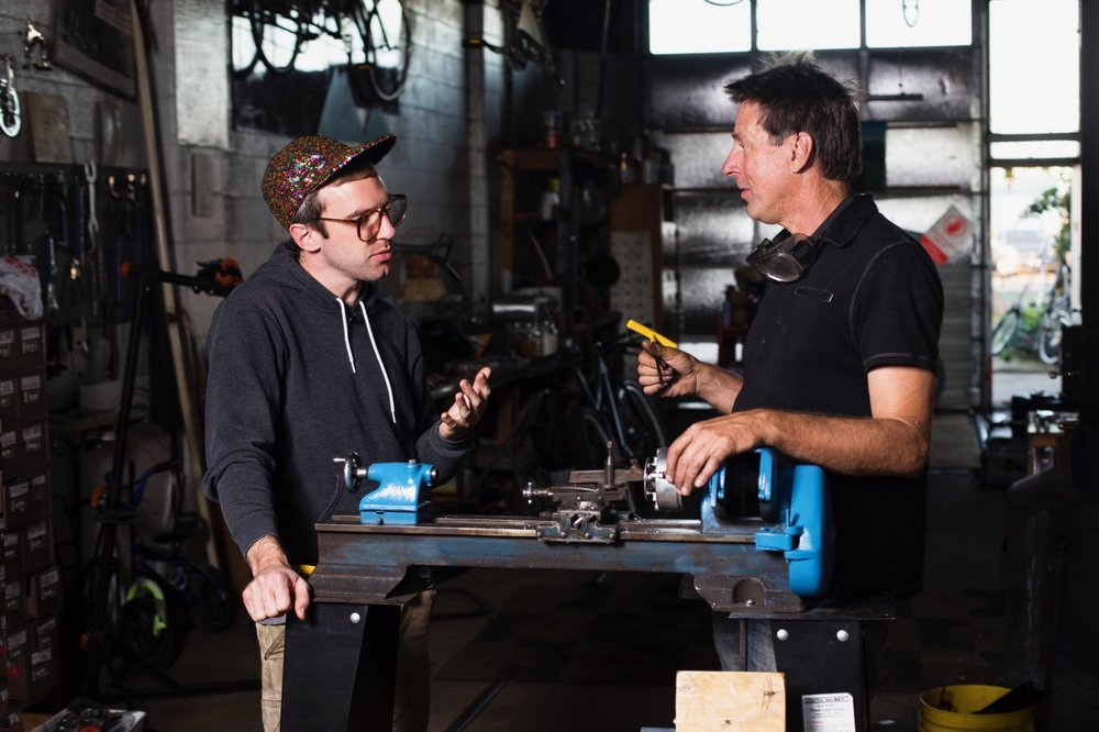 Inventor Neil Kearns discusses his pedal-powered metal lathe with Matthew during filming of an episode of Bicimakina