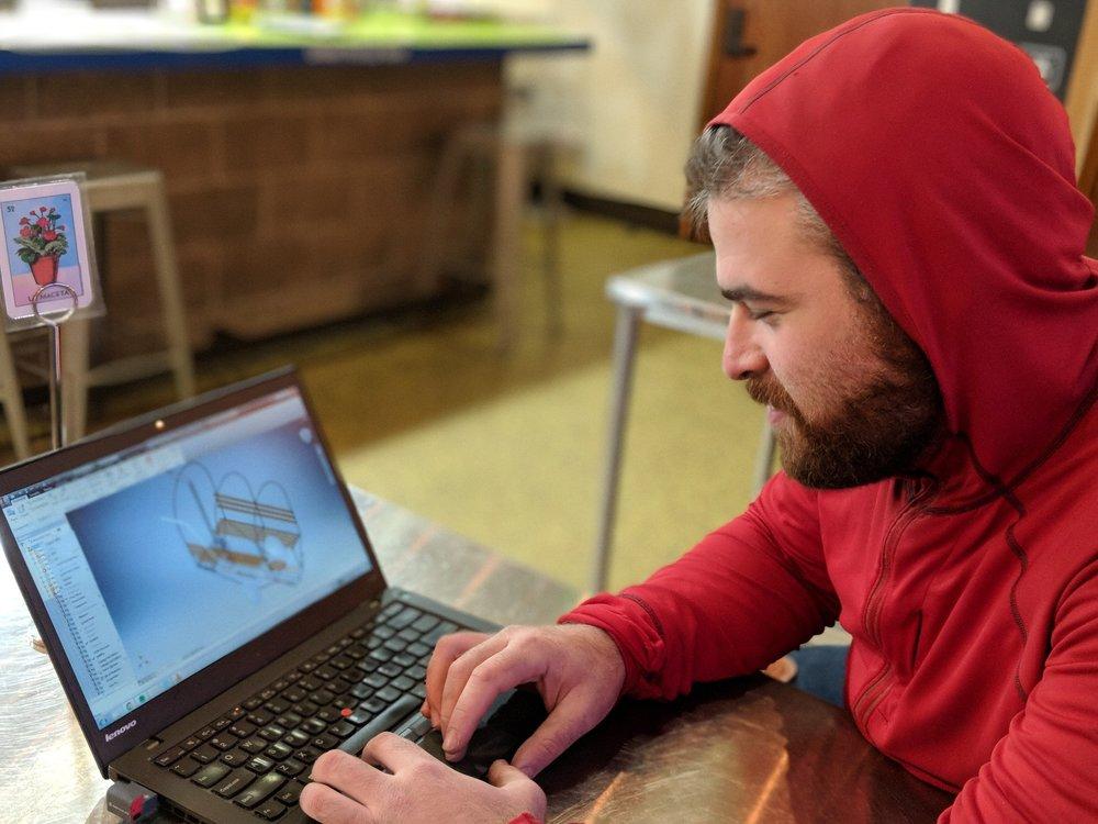Cyclist and sauna enthusiast Alex Seidel shows off a CAD model of his mobile bike-sauna