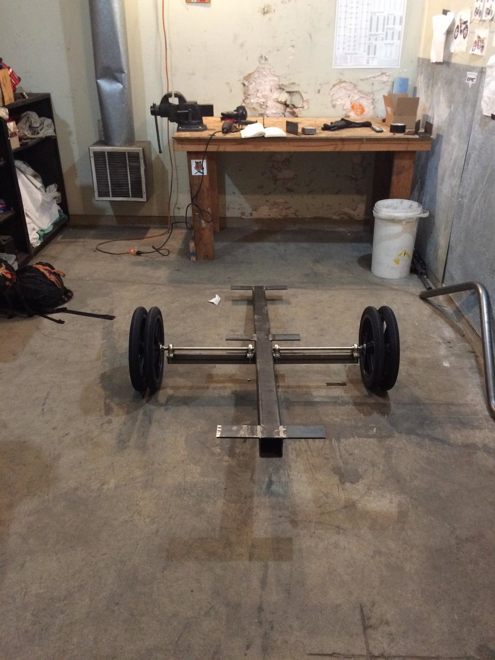 """Doubled-up 12"""" trailer wheels on two separate 5/8"""" stainless steel axles sit between four pillow blocks, giving the steel frame a durable means for mobility"""