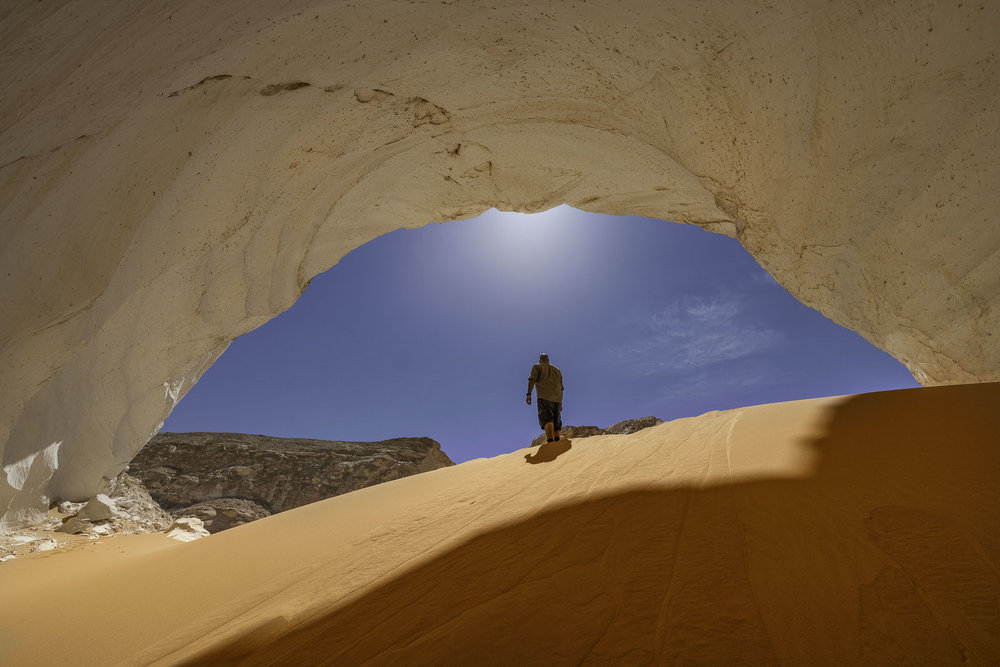 A natural cave surrounded with sands dunes at the Egyptian western desert