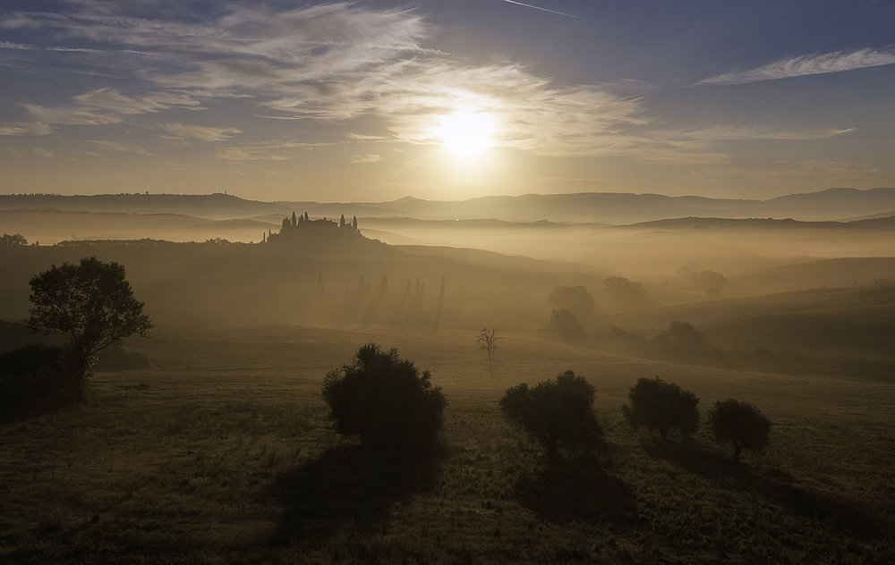 A misty sunrise at Podere Belvedere. San Quirico d'Orcia. Val d'Orcia