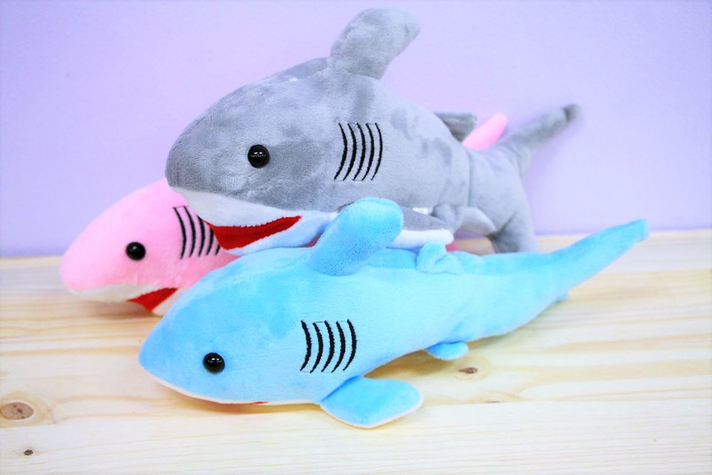Shark Plush Toys - R 65 each - Available in grey, blue and pink.
