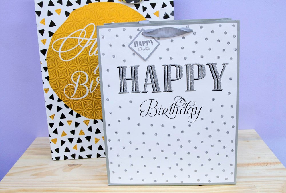 Birthday Gift Bags - R 35 to R 45 - Silver glitter and large gold designs.