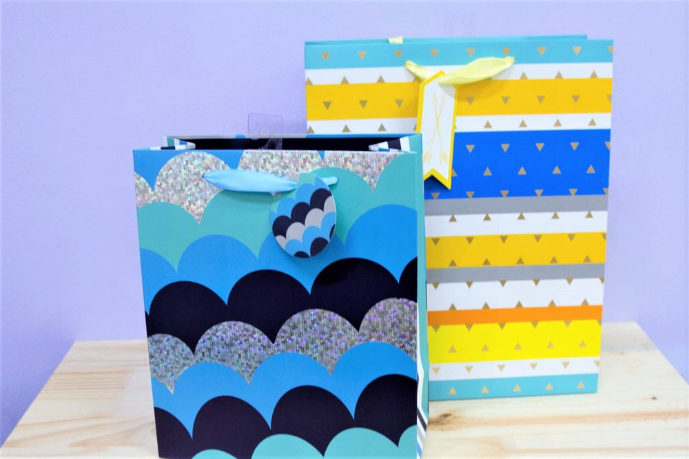 Gift Bags for Boys - R 35 each - Striped and blue wave designs.