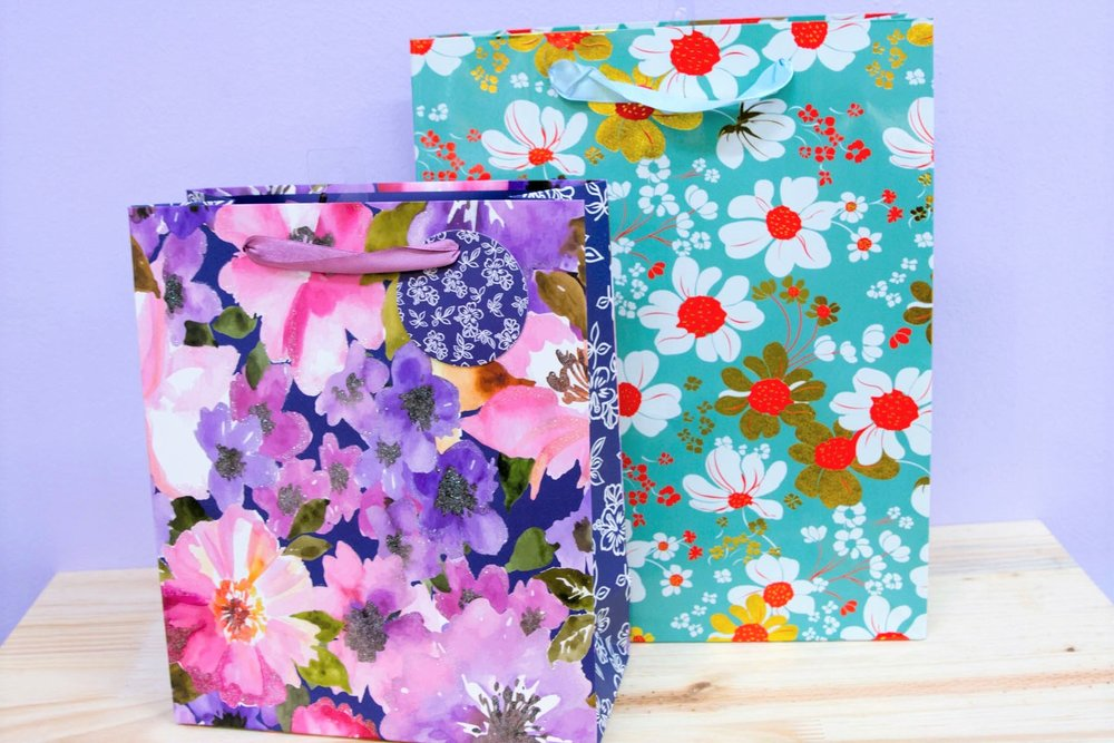 Floral Gift Bags - R 35 each - Purple floral & green floral designs.