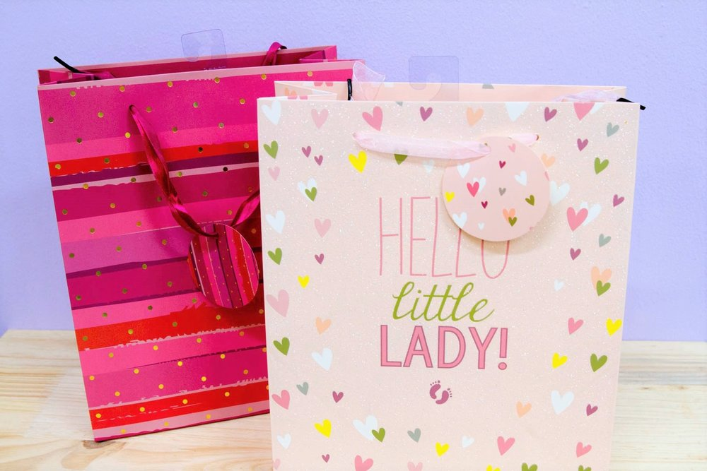 Girly Gift Bags - R 35 each - Bright pink with spots & little lady designs.