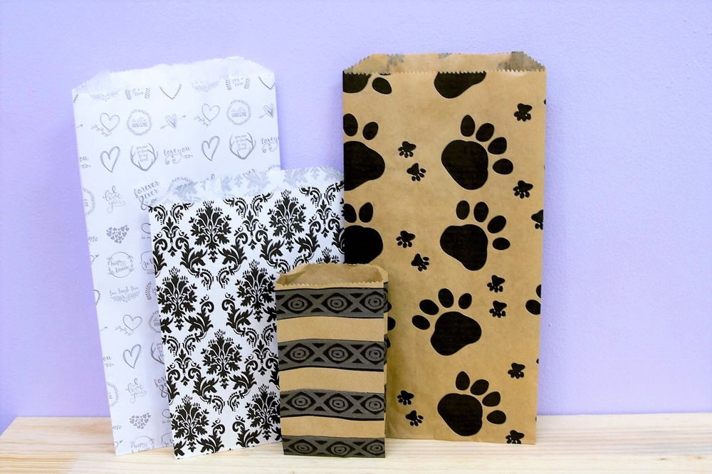 Assorted Paper Bags - R 5 to R 25 - Love You, Paw Print, Black Damask and Small Striped designs.