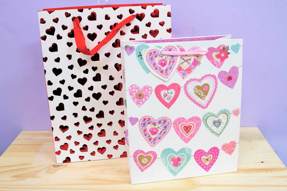 Love Themed Gift Bags - R 35 each - Red heart and colorful heart designs.