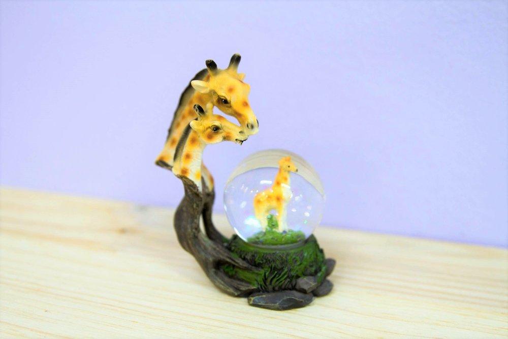 Giraffe Snow Globe - R 150 - Giraffe sparkly snow globe souvenir.
