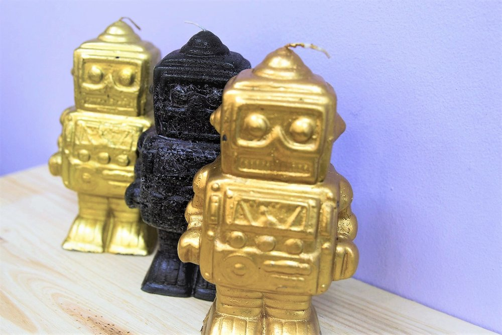 Robot Sculpted Candles - R 190 each - 3 colors available as pictured.