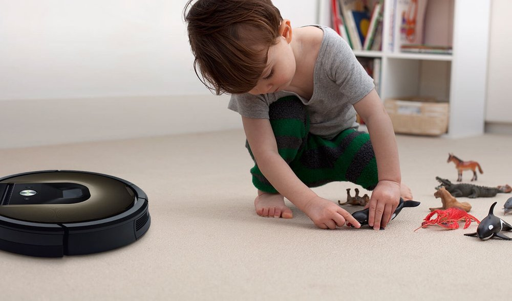 child with roomba.jpg