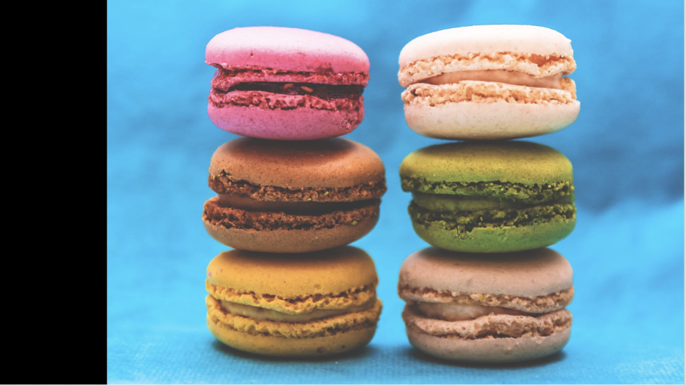 4:3 macarons image on a 16:9 slide. A black bar shows the difference between the rectangle shapes.