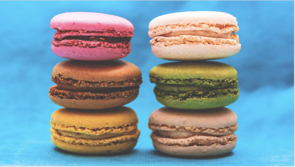 The same macarons image, but it's stretched to fill the slide. It looks mostly ok here — just flattish macarons — but not everything can be stretched.