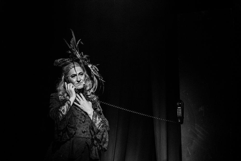 Priscilla Queen of the Desert man in drag sad on phone
