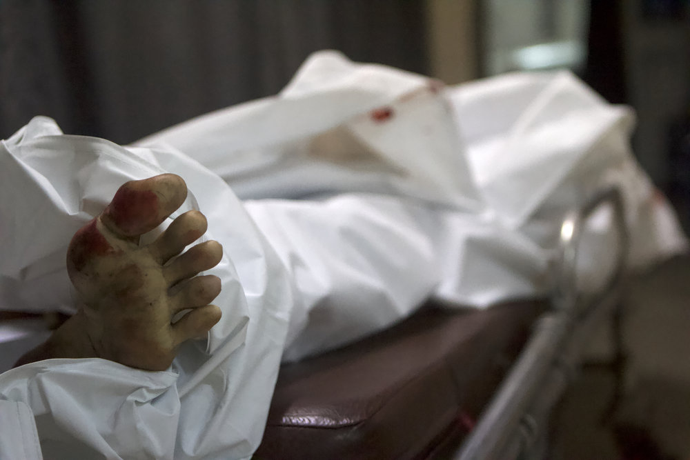 The body of Andy Parpan inside a funeral home in Pasay City, Manila.