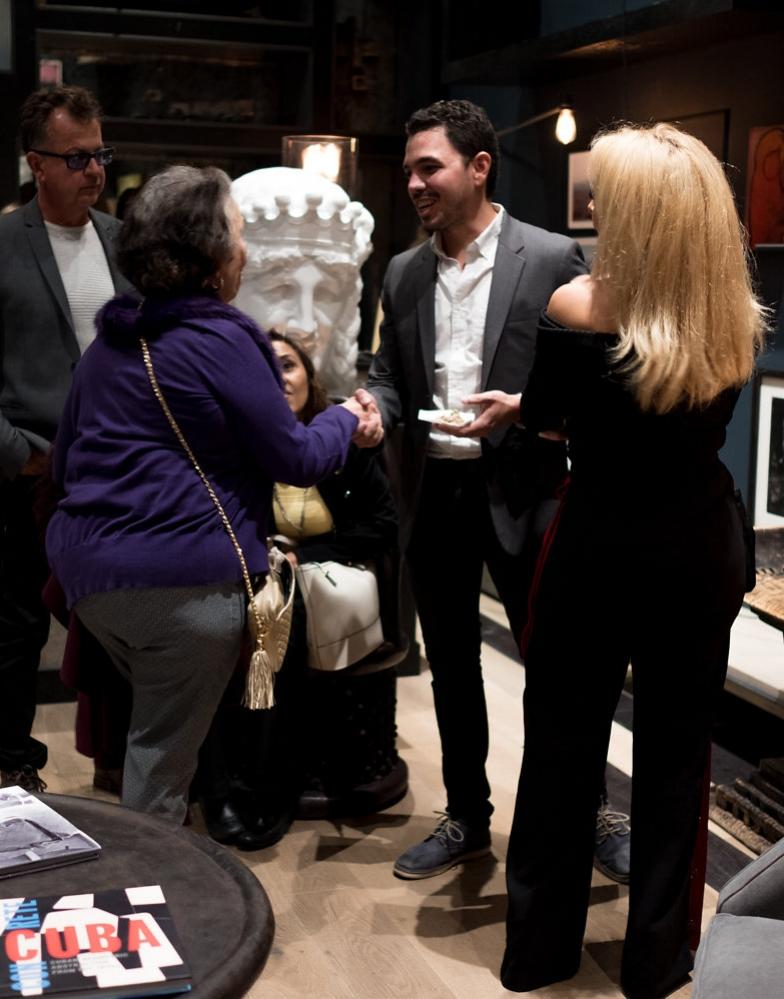 "Artist Roger Toledo Bueno meets with patrons at the ""FUTURE MOVES SLOW"" opening - 11, November 2017."