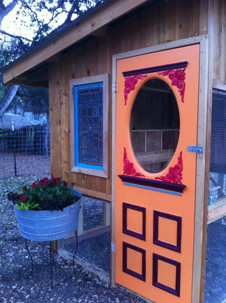 Our chicken coop has a vintage door and stained glass window. because things can be functional  and  cute, too!