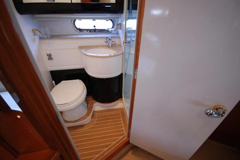 Restroom with private shower cabin