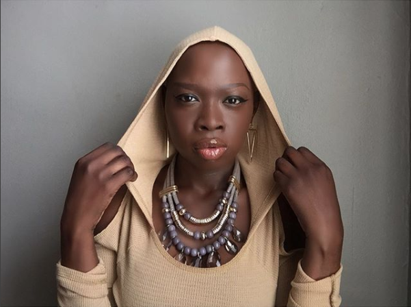 Ebony, a young woman with Alopecia and Miss Michigan pageant contestant, shares a post from her Instagram feed