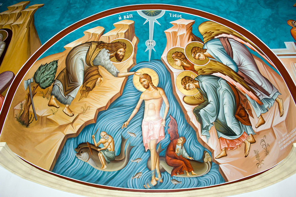 This mural, painted on the interior of the John the Baptist Church at the Jordan River, depicts Jesus' baptism by the hand of John.