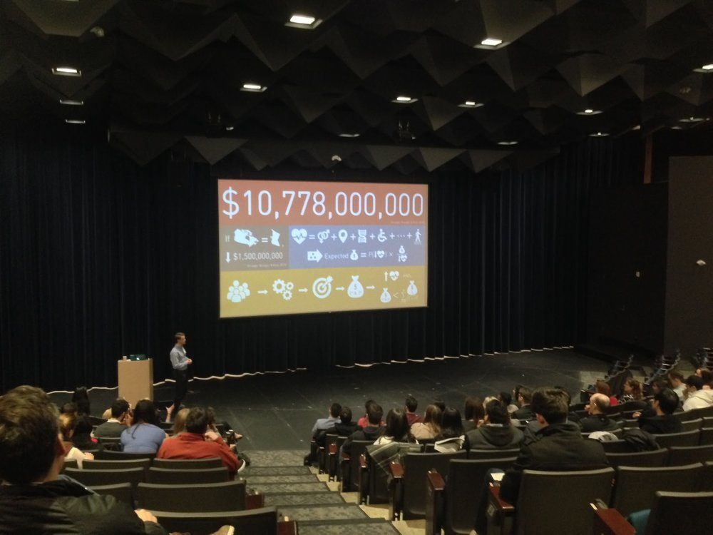 Tim presenting during the 3MT competition, Research Day 2017