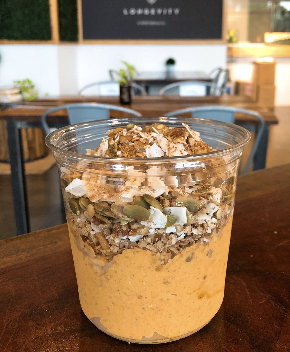 "'The Great Pumpkin Bowl' - From E+ROSE Wellness Cafes, this nutrition powerhouse is loaded with vitamins, minerals and superfoods. It also packs a great combo of carbohydrates, fats, and protein. We've got pumpkin (carb), banana (carb), coconut milk (fat), almond butter (fat, protein), pecans (fat, protein) and some other great additions like cinnamon, nutmeg and vanilla that provide health benefits beyond the ""basics"" we're talking about here."