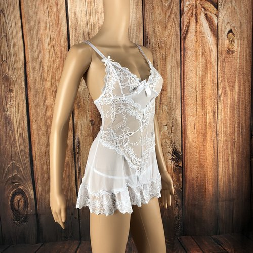 Stunning Stephanie White Bridal Chemise - Bring on the newlywed romance with this stunning white bridal chemise. This flirty babydoll features a lace front with ruffle trim, mesh back, large satin bow and matching thong.