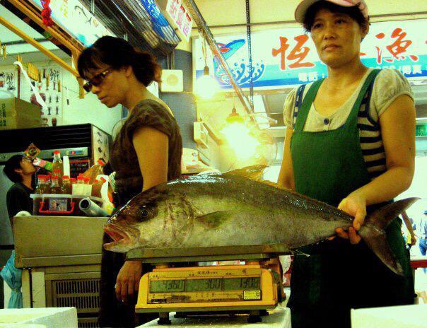 Weighing fish at the fish market.