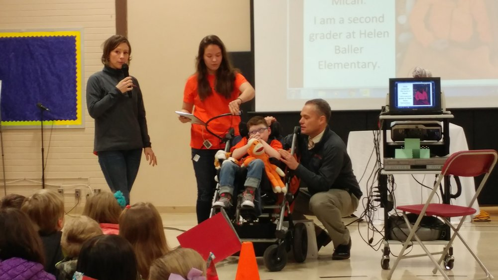 The Micah's Miles Team making a presentation at an elementary school.