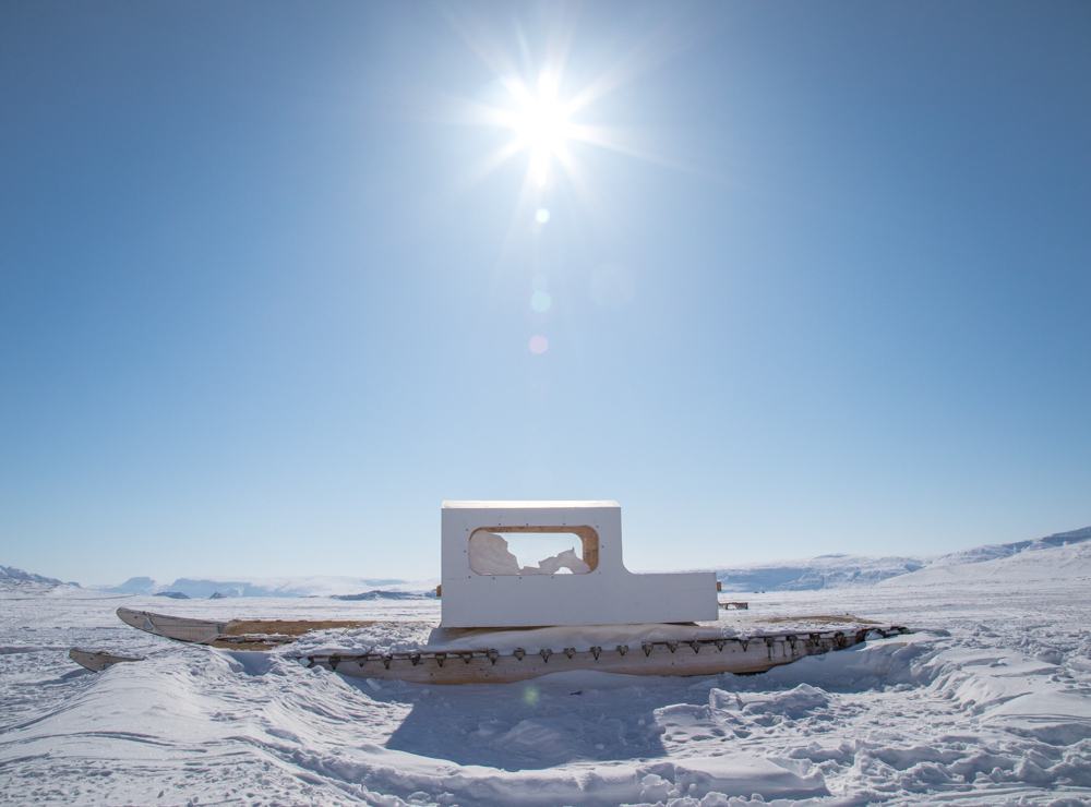 A  qamutik  - sled designed to pull behind a snowmobile or dog team - awaits use on the sea ice outside of town.
