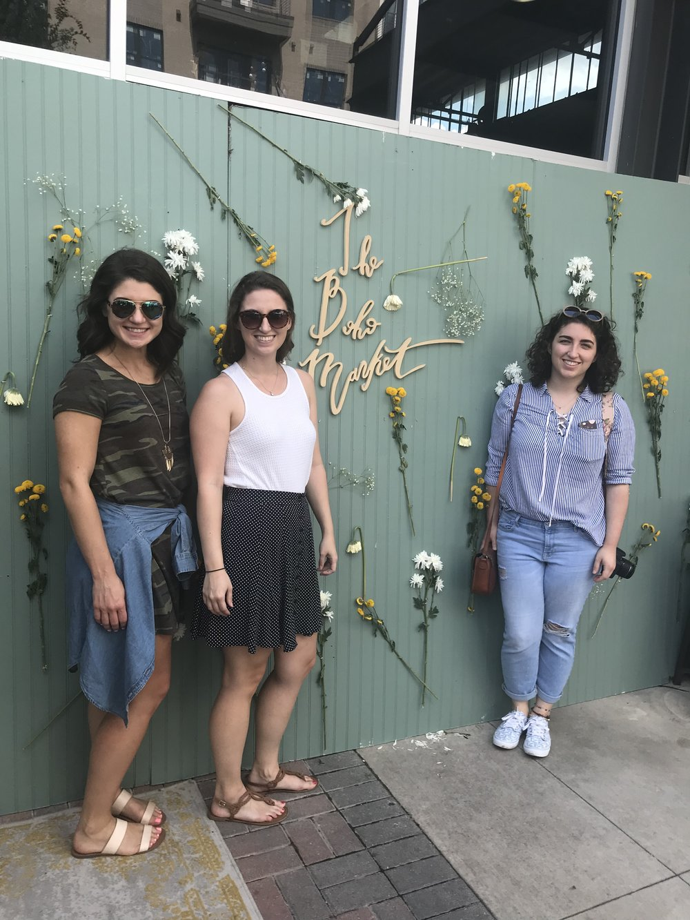 We can't say no to a good photo wall. Even if the flowers were wilted.