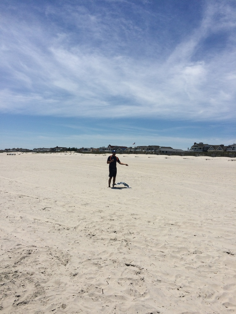 One awesome Dad, trying to fly a kite.