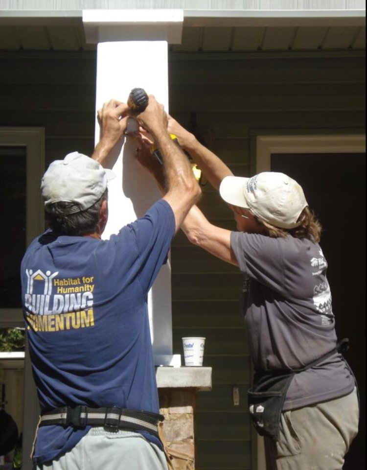 Mom and Dad, working to build someone else a home on a Habitat for Humanity trip.