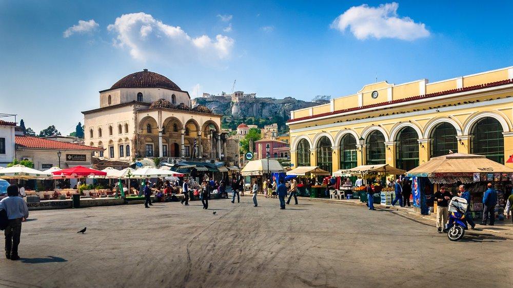 Lively and buzzing atmosphere at Monastiraki square. Source:  Wikimedia