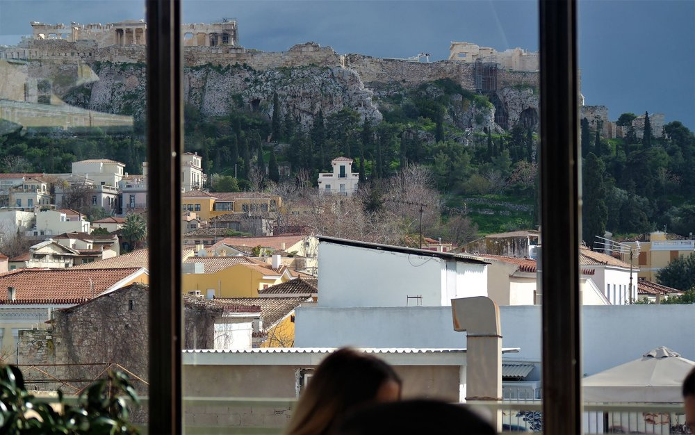 Acropolis looks amazing even with cloudy weather from Couleur Locale's rooftop bar. Source: Truevoyagers