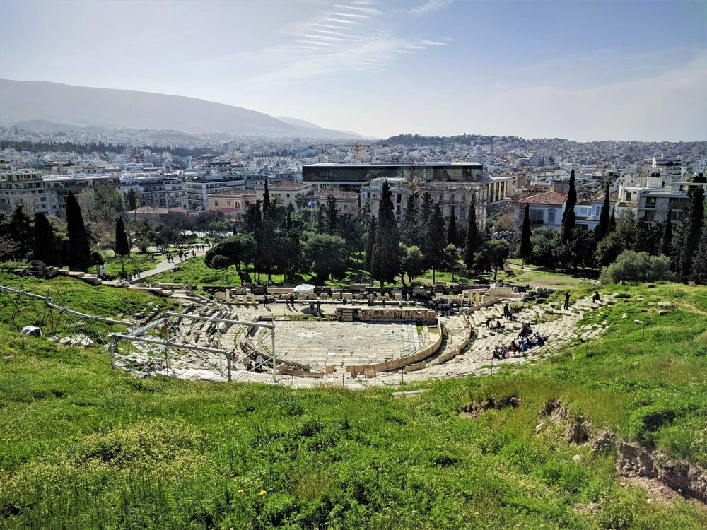 Theatre of Dionysus as seen from Acropolis Hill. Source: Truevoyagers