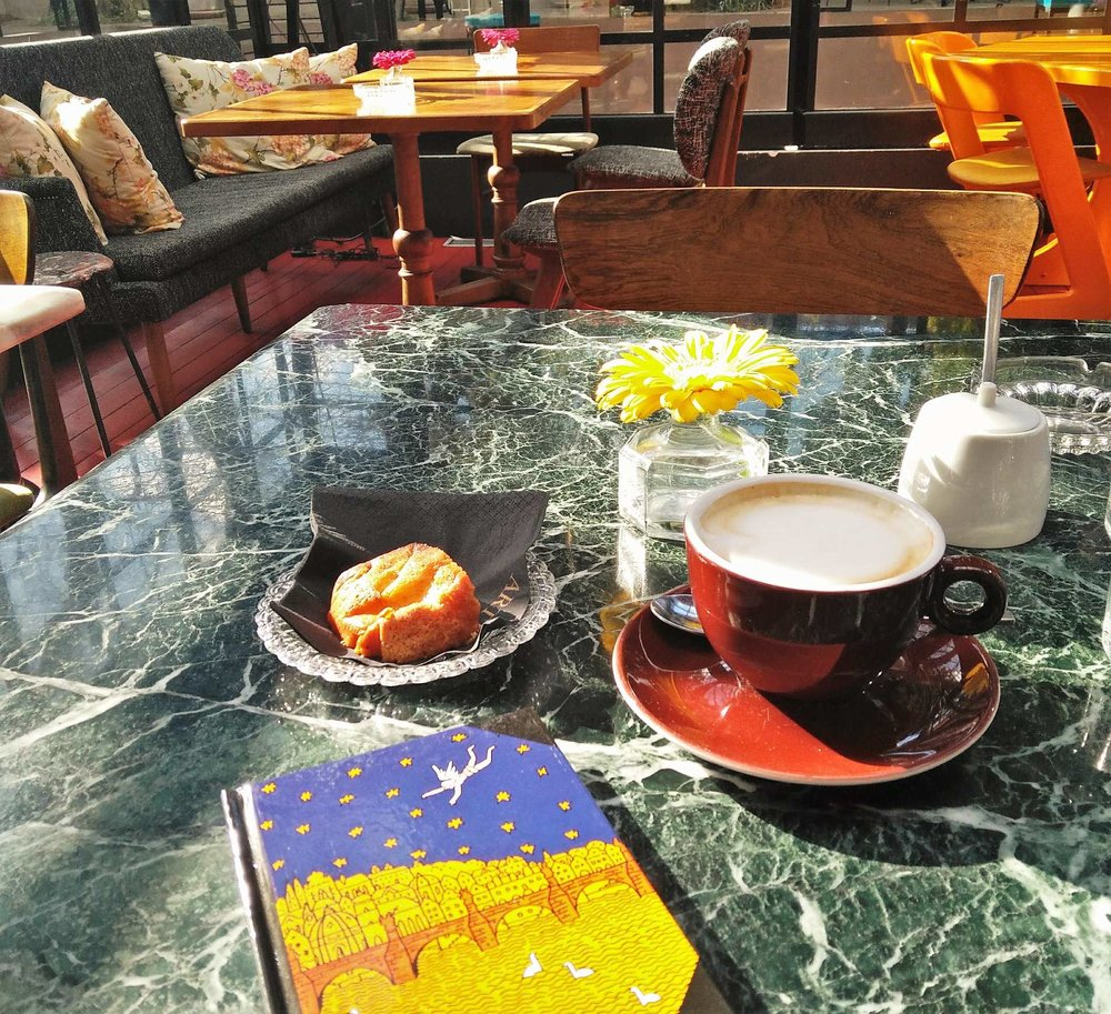 Enjoy your coffee on a sunny day in Athens with the company of a good book or of your travel journal! Source: Truevoyagers