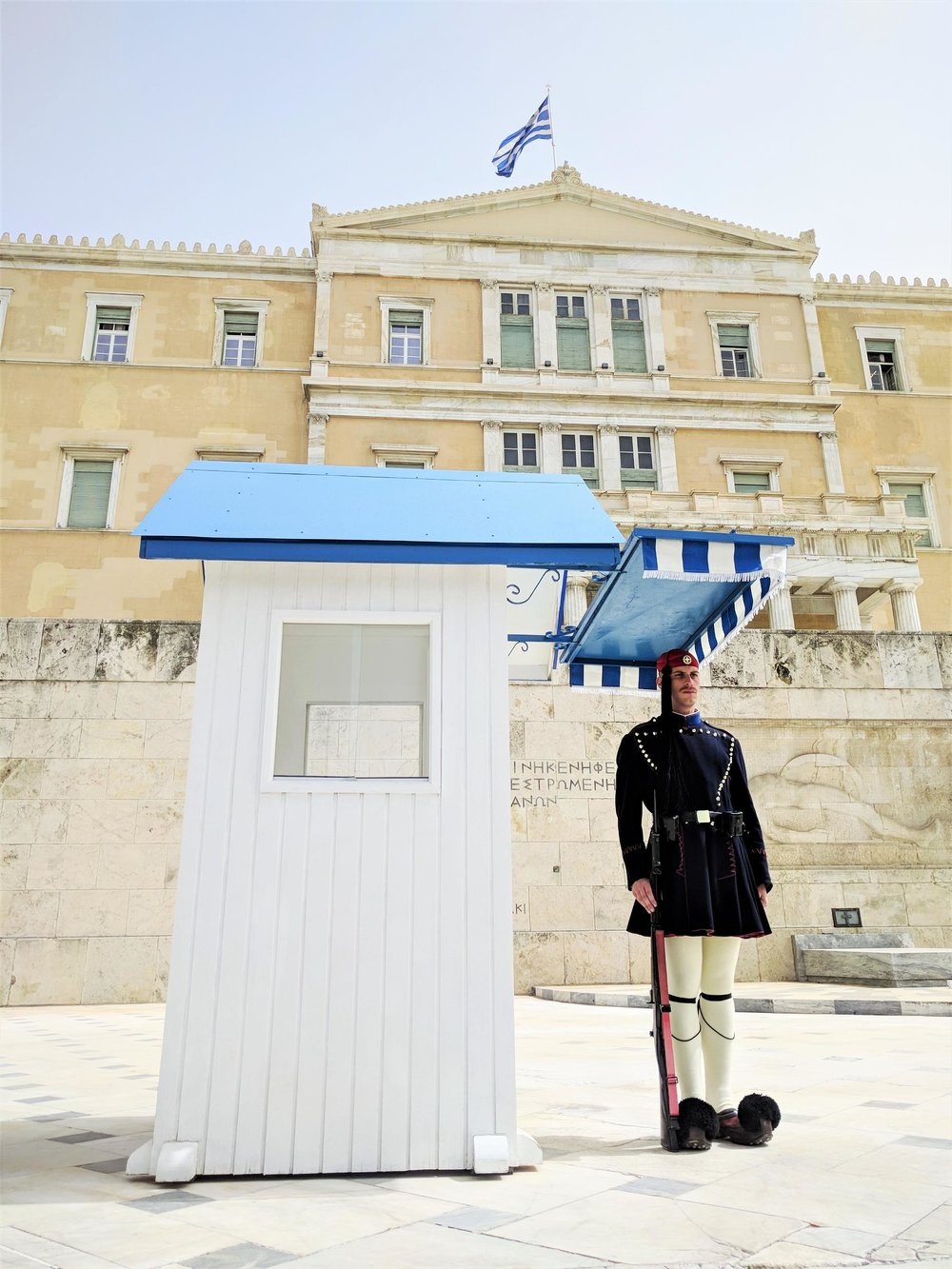 The Parliament guard ( tsolias  or  evzonas ) wearing the traditional uniform and shoes ( tsarouchia ). Source: Truevoyagers