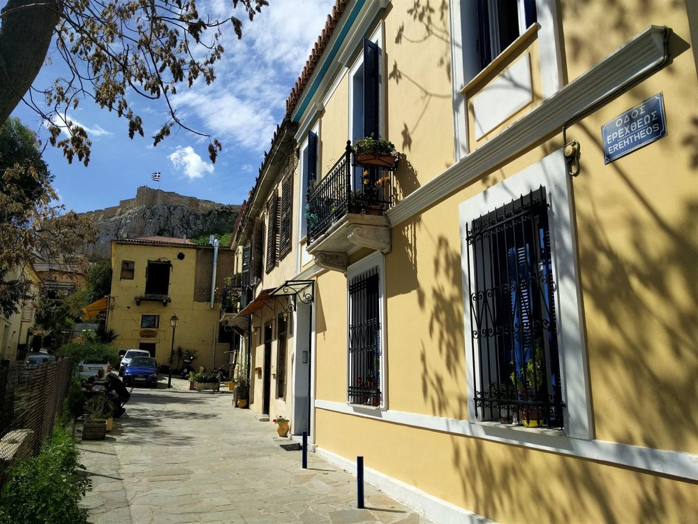 Stroll around Plaka and observe the full of character quaint colorful buildings. Source: Truevoyagers