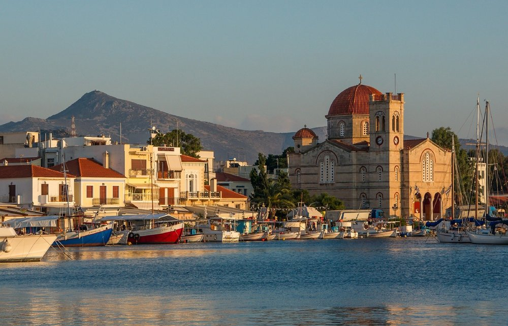 Sunset at the picturesque harbor of Aegina island. Source: Pixabay