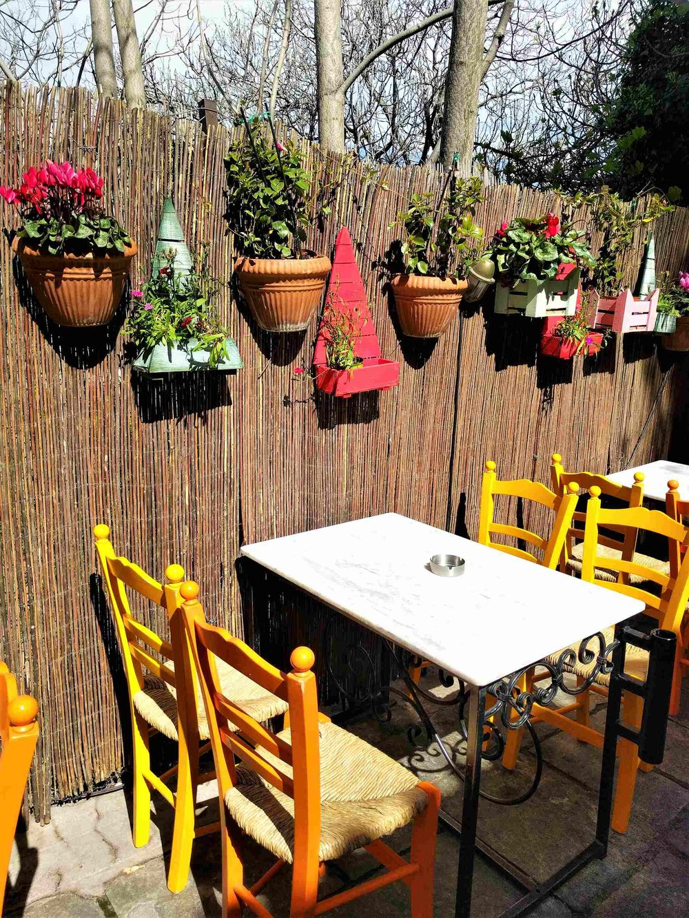 Plaka is full of small restaurants and cafes offering outdoor sitting. Here:  To Kafeneio.