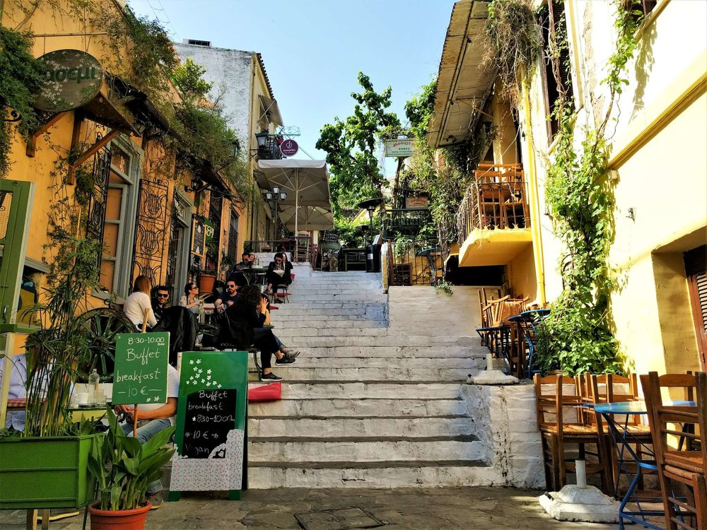 Plaka in Athens is filled with quaint cafes and restaurants, including  Gerani  and  Yiasemi  which are depicted here.