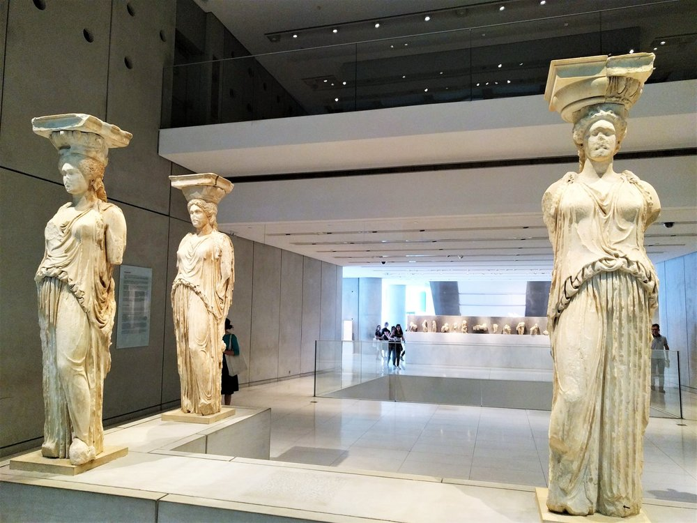 Inside the Acropolis Museum, you can see the Caryatids, some of the most intact exhibits of the Erechtheum, one of the Acropolis buildings.