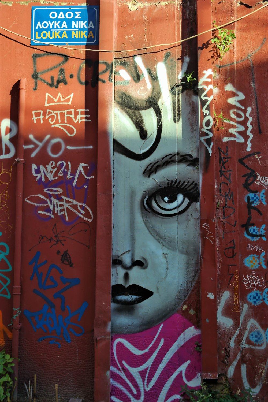 """""""I am watching you"""" type of graffiti statement."""